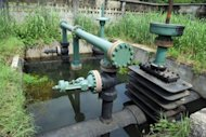 A Shell oil secured inlet manifold is seen in the Niger Delta swamps in 2010. Shell said Thursday it had shut down an oil processing facility in southern Nigeria over a pump failure, but denied reports that a significant amount of oil had spilled in the area. (AFP Photo/Pius Utomi Ekpei)