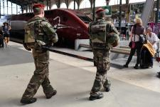 FILE - In this Aug .22 2015 file photo, French soldiers patrol at Gare du Nord train station in Paris, France. The attack Aug. 21 on the Thalys train ...