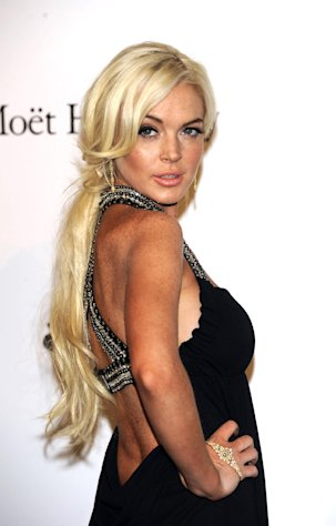 FILE -- In a Sept. 23, 2011 file photo Lindsay Lohan poses at the Amfar charity event in Milan, Italy. Los Angeles County records online show Lohan was booked into a jail in Lynwood on Sunday night, Nov. 6, 2011. (AP Photo/Giuseppe Aresu/file)