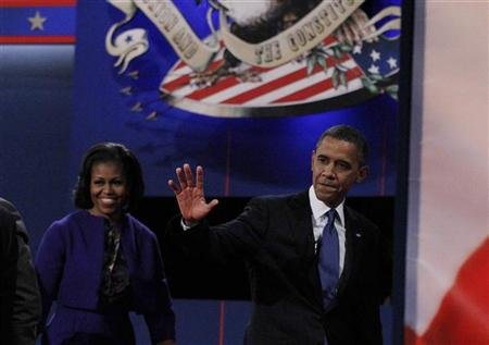 President Obama and his wife Michelle depart at the end of the first presidential debate in Denver