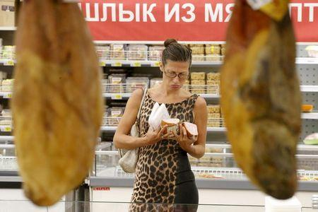 File photo of customer choosing sausage at Auchan grocery store in Moscow