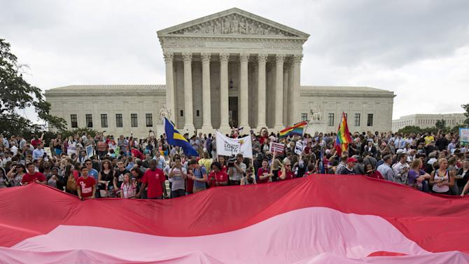 Supporters of gay marriage rally after the U.S. Supreme Court ruled on Friday that the U.S. Constitution provides same-sex couples the right to marry