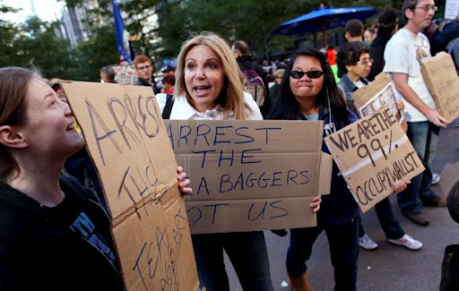 From left, Jamie Carr, of Clifton, N.J.; Suzanne Lauren, of Jersey City, N.J.; and Tirsa Costiniano of New York speak to people passing along Broadway at the Occupy Wall Street protests at Zuccotti Park in New York Monday, Oct. 17, 2011 as the protest enters its 30th day. (AP Photo/Craig Ruttle)
