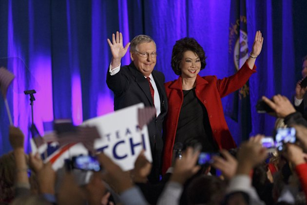 Senate Minority Leader Mitch McConnell of Kentucky, joined by his wife, former Labor Secretary Elaine Chao, celebrates with his supporters at an election night party in Louisville, Ky., on Nov. 4, 2014. (J. Scott Applewhite/AP)