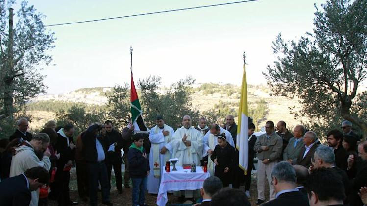 The Beit Jala's Roman Catholic parish priest leads a mass to protest against an Israeli decision to build a new section of the separation wall through the Cremisan valley on January 24, 2014 near the West Bank city of Bethlehem