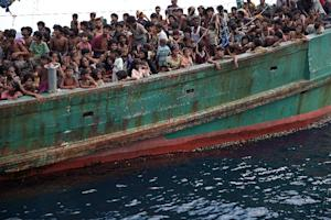 Rohingya migrants on a boat drifting in Thai waters …