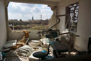 A view shows a damaged clinic after airstrikes by pro-Syrian …