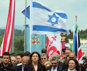 International delegations with flags arrive for a ceremony…