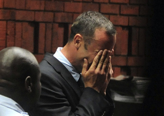 South African 'Blade Runner' Oscar Pistorius breaks down during his court appearance in Pretoria
