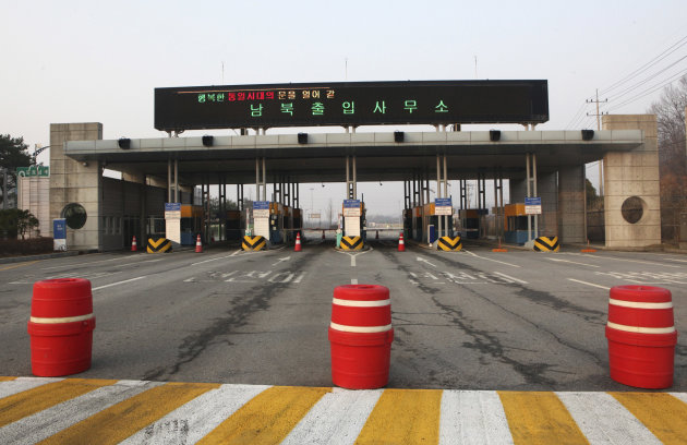 The gateways to the North Korea's city of Kaesong are shut down at the Inter-Korean Transit Office in Paju, South Korea, near the border village of Panmunjom, Thursday, April 4, 2013. North Korea on Wednesday barred South Korean workers from entering a jointly run factory park just over the heavily armed border in the North, officials in Seoul said, a day after Pyongyang announced it would restart its long-shuttered plutonium reactor and increase production of nuclear weapons material. The letters at top read