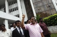 Vijitha Herath (front) of the People's Liberation Front party gestures as he leaves the Supreme Court in Colombo, January 3, 2013. REUTERS/Dinuka Liyanawatte