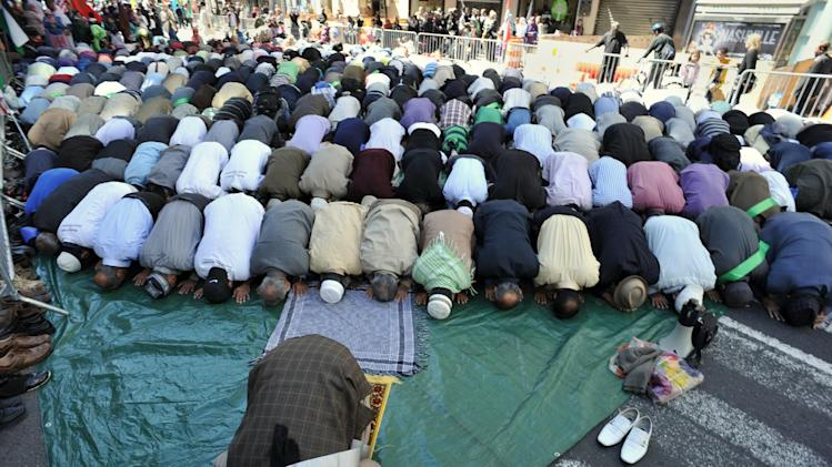 File picture shows Muslim men praying on Madison Avenue in New York just before the 27th annual Muslim Day Parade in New York on September 23, 2012