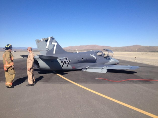 This June 13, 2013 photo provided by the Reno Fire Department shows a Czech-built military training jet sitting on the runway at Reno Stead Airport after it collided with another plane and suffered tail damage. The pilot was forced to make a belly landing during safety training for the 50th National Reno Air Races in Reno, Nev. Neither pilot was injured. The airport 20 miles north of Reno is the site where a pilot and 10 people on the ground were killed in a crash in September 2011. (AP Photo/Reno Fire Department, Chief Michael Hernandez)