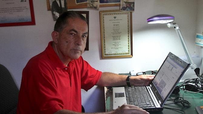 Journalist at Israel's Haaretz newspaper, Gideon Levy poses in his home on August 12, 2014 in the coastal Israeli city of Tel Aviv