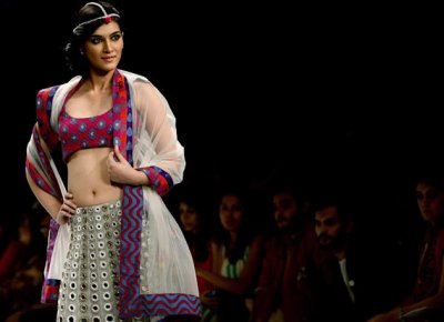 An Indian model displays a creation by Payal Singhal during the Lakme Fashion Week in Mumbai, India, Friday, Aug. 3, 2012. (AP Photo/Rafiq Maqbool)