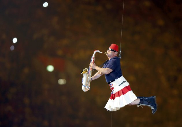A performers take part in the closing ceremony of the London 2012 Olympic Games at the Olympic Stadium