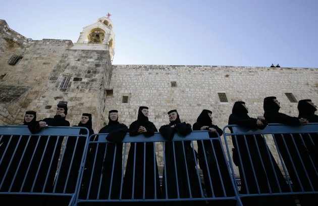 A file photo shows nuns waiting for the Eastern Orthodox Christmas procession outside the Church of the Nativity in Bethlehem