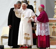 Pope Benedict XVI blesses the faithful as he arrives to celebrate a mass in Lamezia Terme, Italy, Sunday, Oct. 9, 2011. At right is Lamezia Bishop, Luigi Cantafora. (AP Photo/Adriana Sapone)