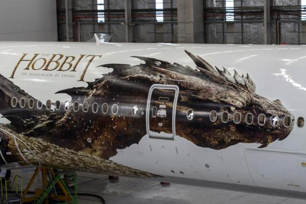 "In this photo taken on Friday, Nov. 29, 2013, released by Air New Zealand, an image of the dragon Smaug from Peter Jackson's Hobbit trilogy, is shown on the side of an Air New Zealand plane in Auckland, New Zealand. The image was unveiled to celebrate the premiere of ""The Hobbit: The Desolation of Smaug,"" which screens Monday in Los Angeles. (AP Photo/Air New Zealand)"