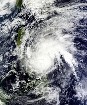 This NASA satellite image shows Typhoon Melor over…