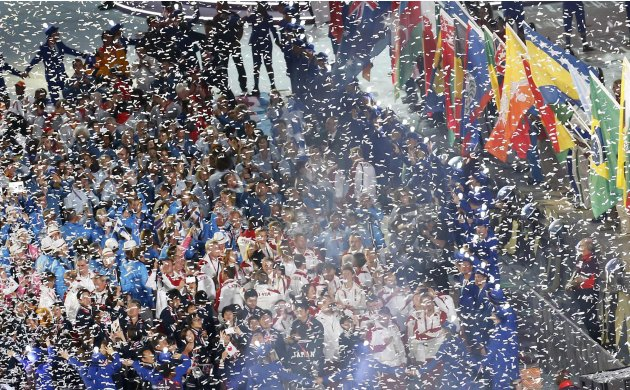 Confetti falls over athletes during the closing ceremony of the London 2012 Olympic Games at the Olympic Stadium
