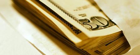 Stack of cash in envelope (Thinkstock)