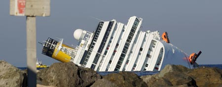 The Costa Concordia cruise ship is seen after it ran aground off the west coast of Italy at Giglio island January 14, 2012. (REUTERS/ Remo Casilli)