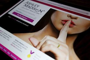 Homepage of Ashley Madison website displayed on iPad, …