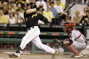 Pittsburgh Pirates' Russell Martin hits a three-run…