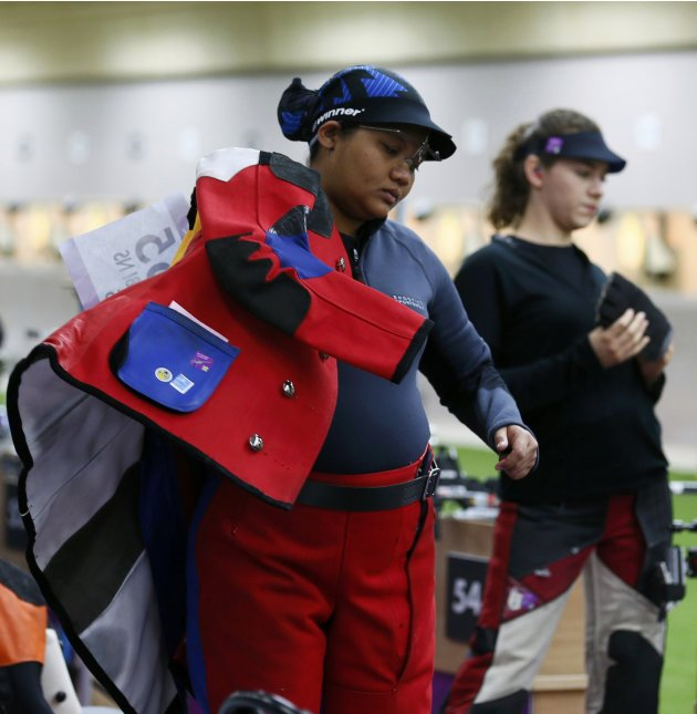 Malaysia's Nur Suryani Mohd Taibi participates in the women's 10m air rifle qualification competition at the London 2012 Olympic Games in the Royal Artillery Barracks at Woolwich in London