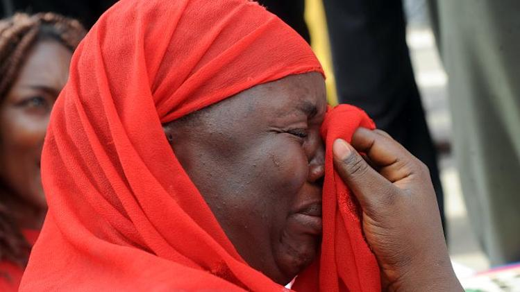 One of the mothers of the missing Chibok school girls wipes her tears as she cries during a rally by civil society groups pressing for the release of the girls in Abuja on May 6, 2014