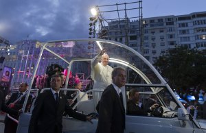 Pope Francis waves from his popemobile as he arrives …