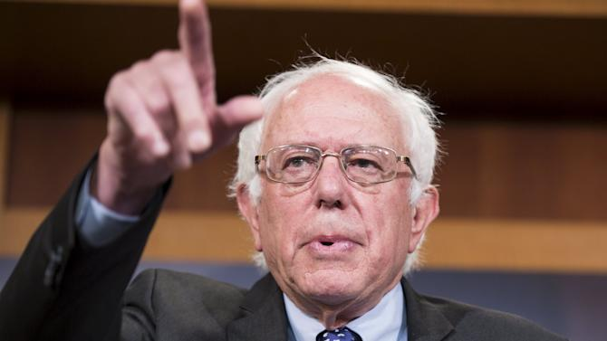 Democratic presidential candidate Sen. Bernie Sanders (I-VT) takes a question during a news conference
