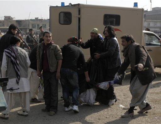 Men carry the body of a victim away after a suicide attack at a Shi'ite Muslim gathering in Kabul