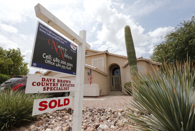 FILE - In this Thursday, Aug. 22, 2013, file photo, an existing home is listed as sold, in Gilbert, Ariz. Freddie Mac, on Thursday, Dec. 12, 2013, reports on mortgage rates for the week. (AP Photo/Matt York, File)