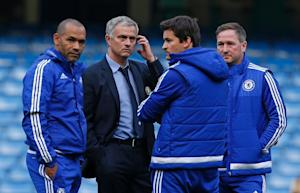 Chelsea manager Jose Mourinho (2nd left) stands with …