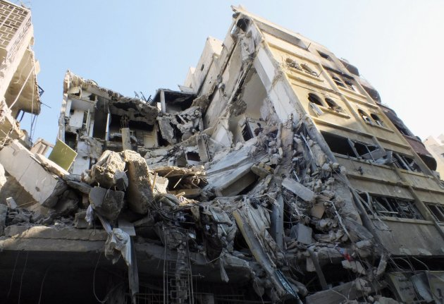 A general view of a building damaged by an air strike at a besieged area in Homs November 28, 2012. Picture taken November 28, 2012. REUTERS/Yazan Homsy  (SYRIA - Tags: CONFLICT)