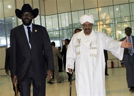 Sudan's President Omar al-Bashir welcomes his South Sudanese counterpart Salva Kiir during his arrival at Khartoum Airport in fil photo. REUTERS/ Mohamed Nureldin Abdallah