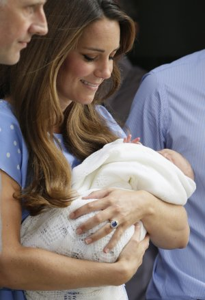 Kate, Duchess of Cambridge holds the Prince of Cambridge, …