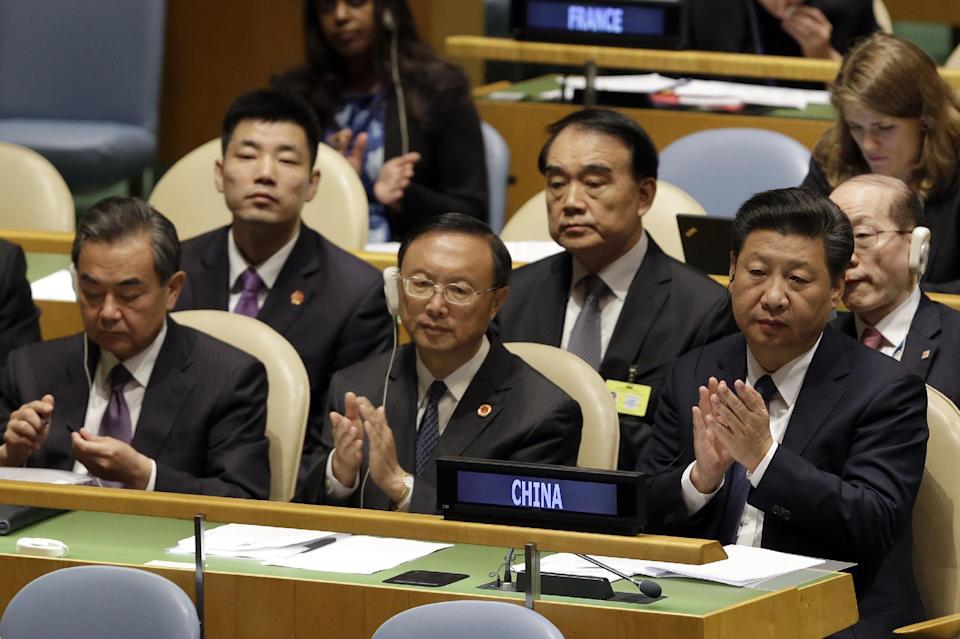 Chinese President Xi Jinping, right, attends the Sustainable Development Summit 2015, Saturday, Sept. 26, 2015 at United Nations headquarters.  (AP...