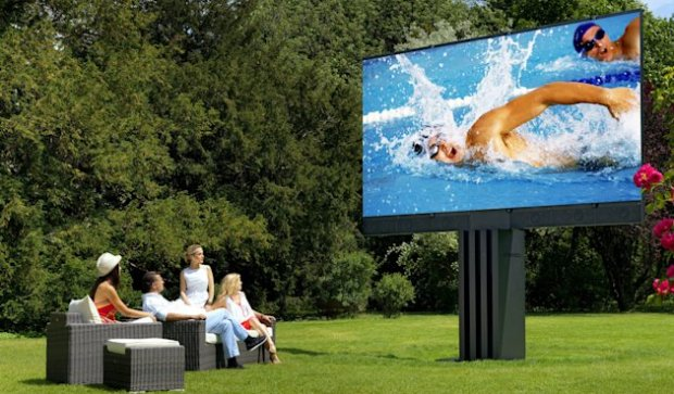 The 201-inch screen rises up out of the ground on a motorised mount, then unfolds. (Image: SWNS)