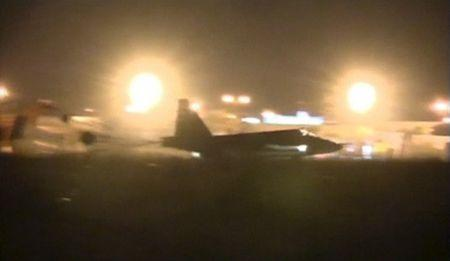 Frame grab shows a Russian military jet taxiing on runway shortly after the landing in Syria