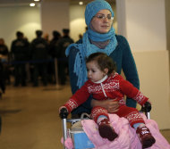 A Russian woman and her child leave passport control zone just after their arrival from Beirut in Moscow Domodedovo airport, Russia, Wednesday, Jan. 23, 2013. The Kremlin's evacuation of Russians from Syria on Tuesday marks a turning point in its view of the civil war, representing increasing doubts about Bashar Assad's hold on power and a sober understanding that it has to start rescue efforts before it becomes too late. The operation has been relatively small-scale - involving fewer than 100 people, mostly women and children - but it marks the beginning of what could soon turn into a risky and challenging operation. (AP Photo/Alexander Zemlianichenko)