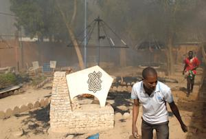 Smoke rises from the courtyard of the Franco-Nigerien…