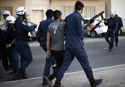 Bahrain riot police arrest a man during clashes…