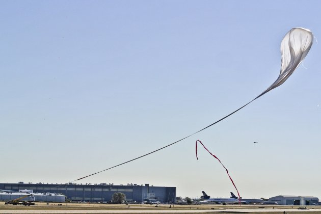 Handout photo of the crane following the balloon with the capsule carrying pilot Felix Baumgartner at the flight line during the final manned flight for Red Bull Stratos in Roswell