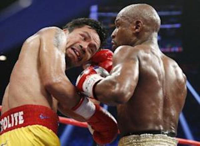 FILE - This May 2, 2015 file photo shows Manny Pacquiao,…