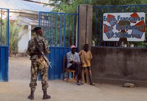 A Cameroonian soldier patrols near the entrance to…