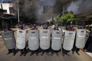 File photo of riot policemen forming up near a fire…