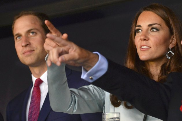 Britain's Prince William and his wife Catherine, Duchess of Cambridge arrive for the opening ceremony of the London 2012 Olympic Games at the Olympic Stadium